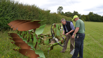 Farmer Morris and Ian Bradley, soil expert, look at the plough